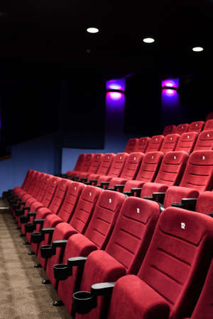Red seats of cinema hall after the movie Stock Photo