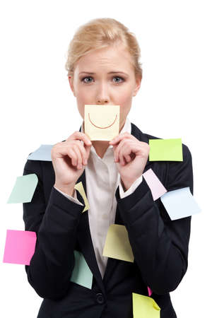 Businesswoman holding a yellow sticker in front of her face, isolated on white background photo