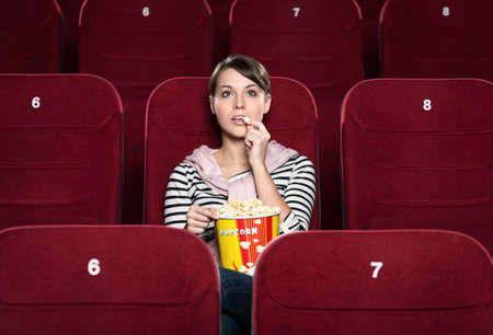 Young girl at the cinema watching a movie Stock Photo - 13740906