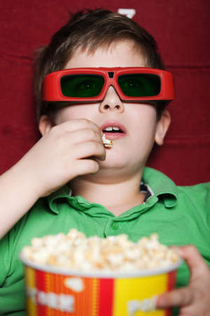 Toddler boy is waiting for a movie Stock Photo - 13740930