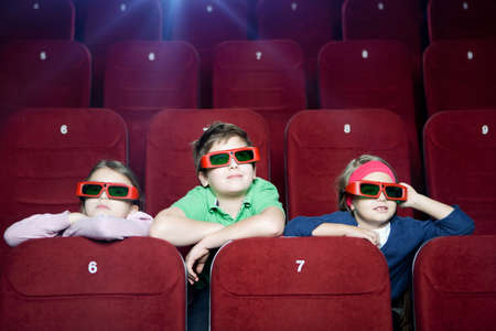 Kids watching 3D cartoon in the movie theater