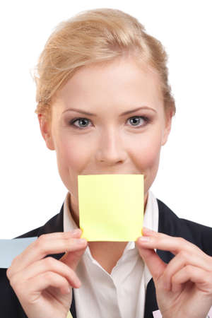 appealing attractive: Businesswoman holding a yellow sticker in front of her face, isolated on white background