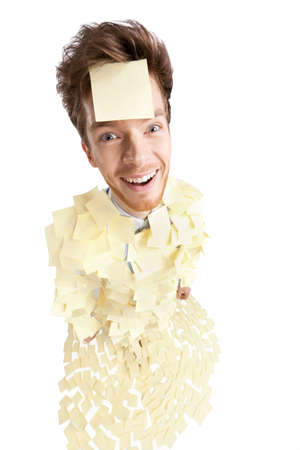 Wide angle shot of young man with a sticky note on his face, covered with yellow stickers, isolated on white photo