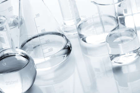 science background: Group of flasks containing liquid over white