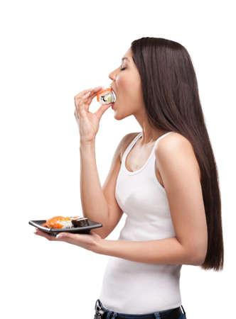 ni�a comiendo: Chica joven que come sushi, aislado Foto de archivo