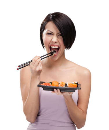 sushi plate: Beautiful girl eating sushi with a chopsticks, isolated Stock Photo