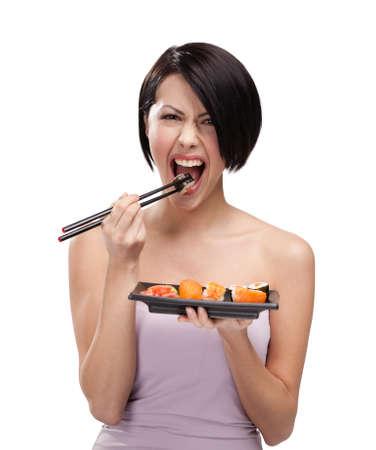 nigiri: Beautiful girl eating sushi with a chopsticks, isolated Stock Photo