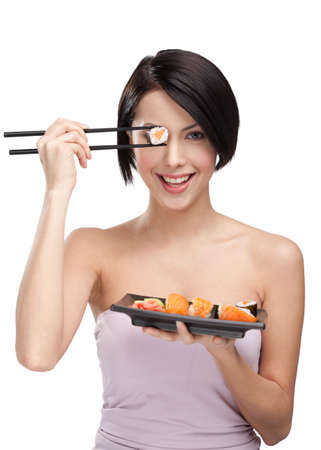 sushi plate: Young woman holding sushi with a chopsticks, isolated on white