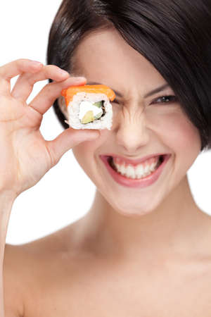 Young girl holding sushi in her hand and smiling, isolated on white photo
