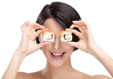Young girl holding sushi in her hand and smiling, isolated on white background on white photo