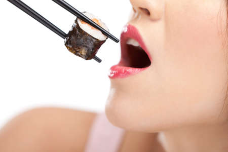 mouth close up: Beautiful girl holding sushi with a chopsticks, closeup, isolated Stock Photo