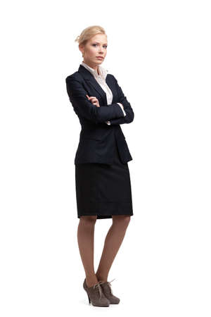 skirt suit: Blonde businesswoman in a black suit, isolated on white background Stock Photo