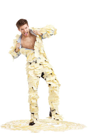 ripping shirt: Young man ripping off his shirt with stickers isolated on white background