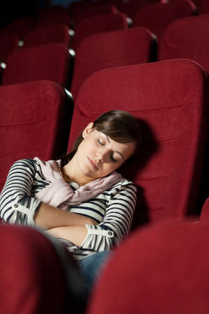 sits on a chair: Tired woman  after the  movie