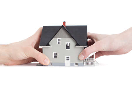 divide: Real estate concept - two hands trying to divide house, isolated