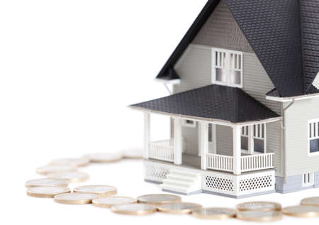 nobody real: Real estate concept - coins around the house architectural model, isolated
