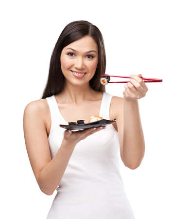Young woman holding sushi with a chopsticks, isolated photo