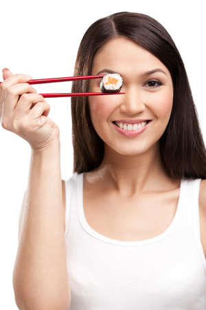 Black-haired attractive girl holding sushi with a chopsticks, isolated Stock Photo - 13894553