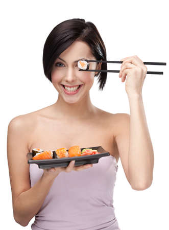 Black-haired girl holding sushi with a chopsticks, isolated photo