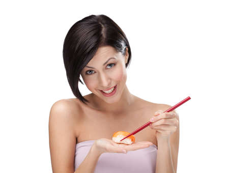 Beautiful woman holding sushi with a chopsticks, isolated on white photo