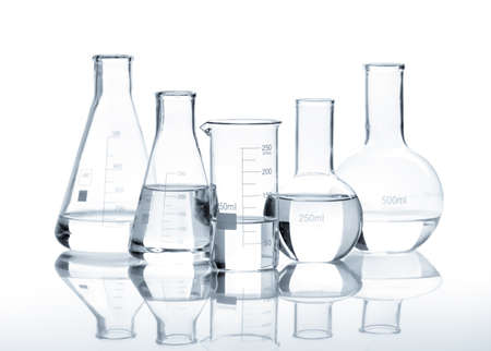 chemically: Five glass flasks with a clear liquid, isolated