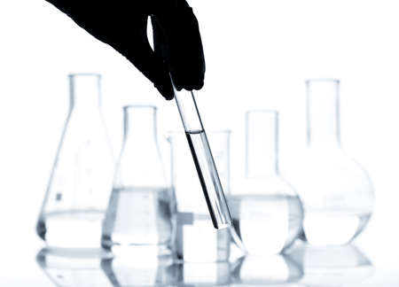 Set of laboratory flasks with a clear liquid, isolated photo