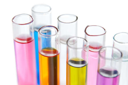 Group of test tubes with a colored reagents in a rack, isolated