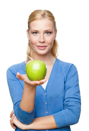 Smiling attractive woman offers a green apple, isolated photo