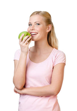 Young woman eating apple, isolated on white background photo