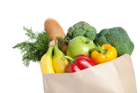 vegetables white background: Closeup of paper bag with healthy food, isolated on white