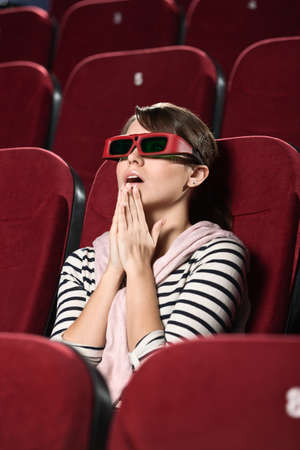sits on a chair: Funky woman at the 3D movie