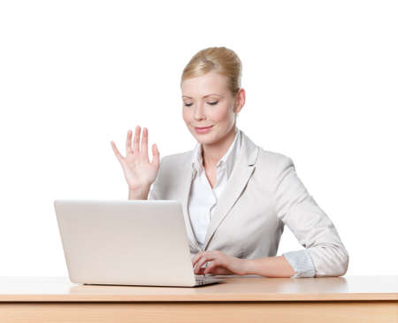 white work: Young business woman sitting at a office table with laptop, isolated