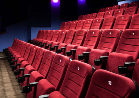theater seat: Empty rows of  red cinema seats Stock Photo