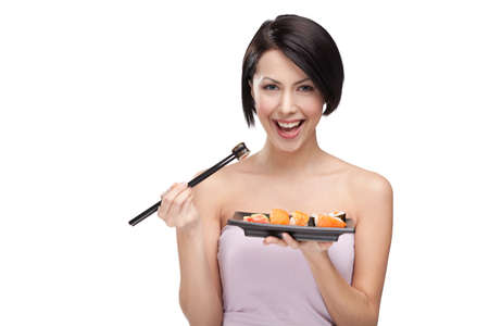 gladly: Black-haired woman eating sushi with a chopsticks, isolated