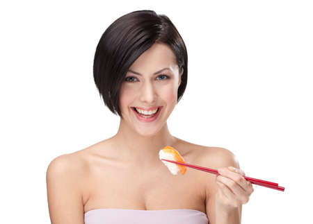 Brunette woman holding sushi with a chopsticks, isolated photo
