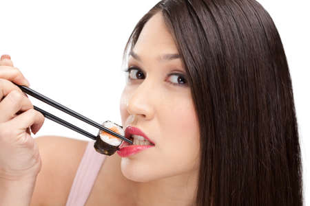 Beautiful girl holding sushi with a chopsticks, isolated Stock Photo - 13994195