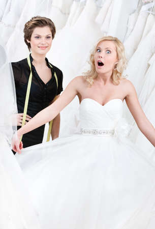 selects: Bride goes into raptures while seeing her wedding gown Stock Photo