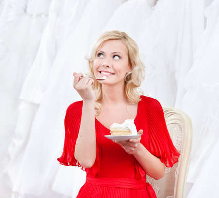 show off: Future bride has the wedding cake, on white background