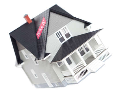 realty residence: Realty concept - house architectural model with sale sign, isolated