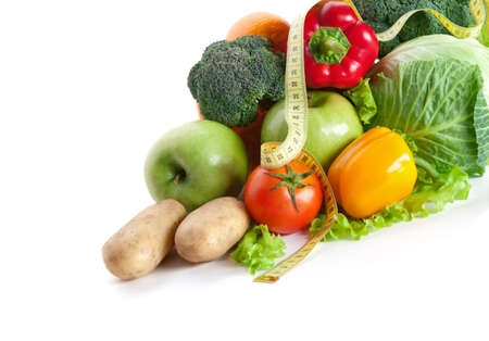 Group of fresh vegetables with a measuring tape, isolated on white photo