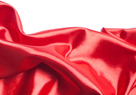 Abstract red silk fabric over white background photo