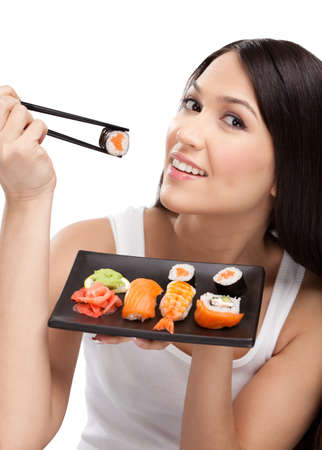 Black-haired girl holding sushi with a chopsticks, isolated on white Stock Photo - 14502188