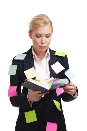 Business woman holding diary with a sticky notes on her suite photo
