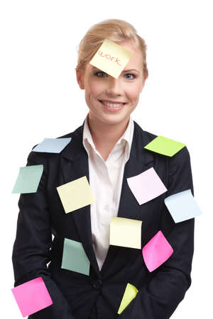 Blonde business woman with colored stickers on her face, isolated on white background photo