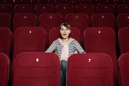 sits on a chair: Positive emotions at the cinema