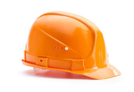 materiales de construccion: Orange duro sombrero, aislados en blanco Foto de archivo