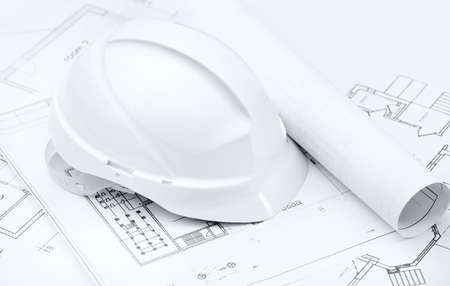 hard stuff: White hard hat on working or engineering drawings on white background