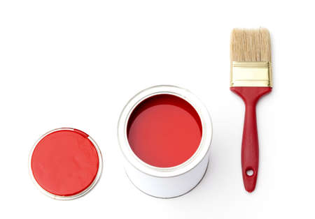 Tin with rad paint, cover and paint brush near the tin, isolated on white photo