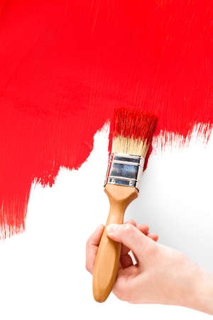 verb: Painting with red and paintbrush on white