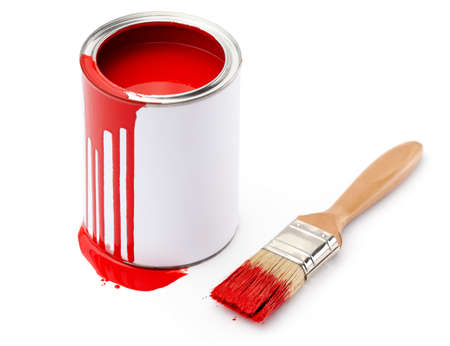 Full of red paint tin and paintbrush which is dirty with red ink, isolated on white background photo